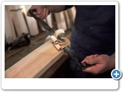 Cricket Bat Maker Tim Kelly making cricket bats from willow wood in his workshop at Ashburnham Sussex England