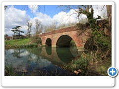 A foot bridge over a pond on the common at Cookham Berkshire
