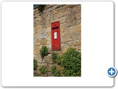 A post box in a wall near the cotswold village of Snowshill