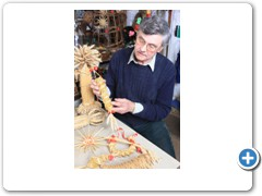Bert Manton making corn dollies, he teaches this craft which goes back thousands of years. Working in his workshop at Woodford Halse in Northamptonshire ( 3 in a set )