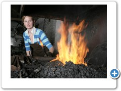 Blacksmith Melissa Cole working in her forge near Marlborough in Wiltshire